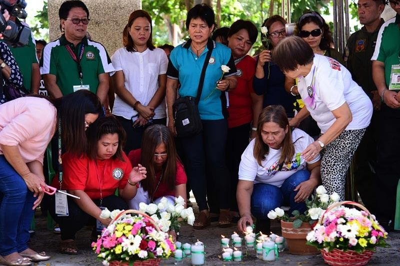 Families and relatives lighted their candles in memory to the victims of the bombing incident back 2003. (Photo by City Government of Davao)