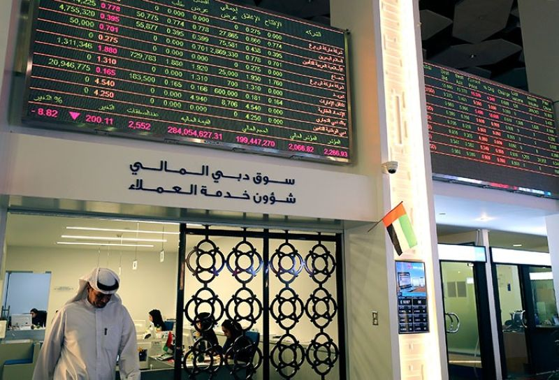 DUBAI. An Emirati trader leaves an office at the Dubai Financial Market in Dubai, United Arab Emirates, Monday, March 9, 2020.  Saudi Arabia closed off air and sea travel to nine countries affected by the new coronavirus Monday as Mideast stock markets tumbled over fears about the widening outbreak's effect on the global economy. (AP)
