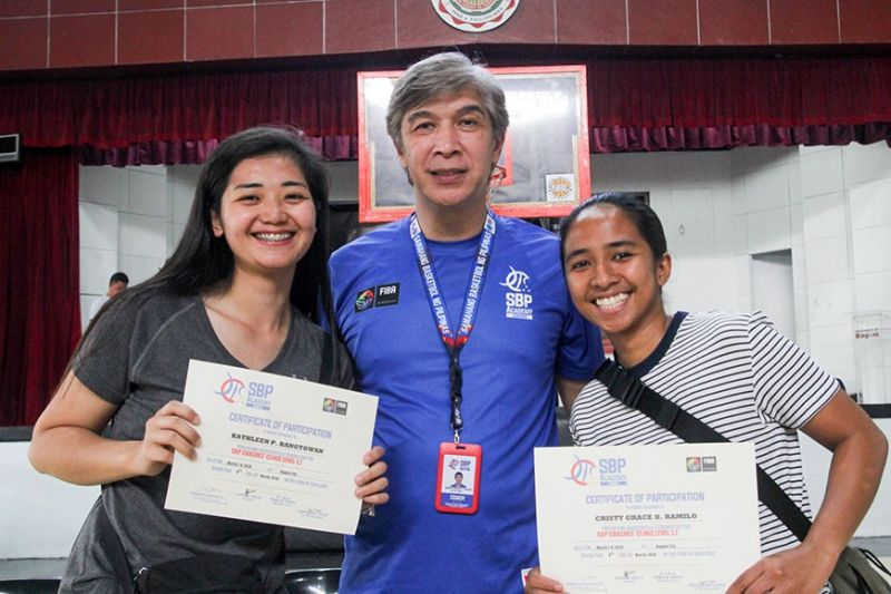 BAGUIO. Former University of the Cordilleras women's basketball player Kathleen Bangtowan (left) and former University of Baguio Cardinals team captain Cristy Ramilo, who are now teachers, flank coach Jong Uichico after completing the Samahang Basketball ng Pilipinas (SBP) coaches clinic level 1.2 at the UB gym on March 8. Photo by Jean Nicole Cortes