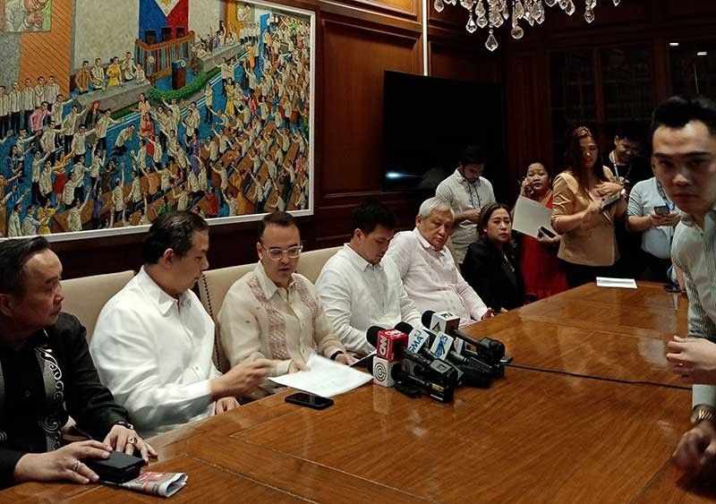 MANILA. House Speaker Alan Peter Cayetano and other members of the House hold a press conference after the House committee on legislative franchises hearing that began discussions on the application of ABS-CBN for franchise renewal on March 10, 2020. (Photo by Jove Moya)