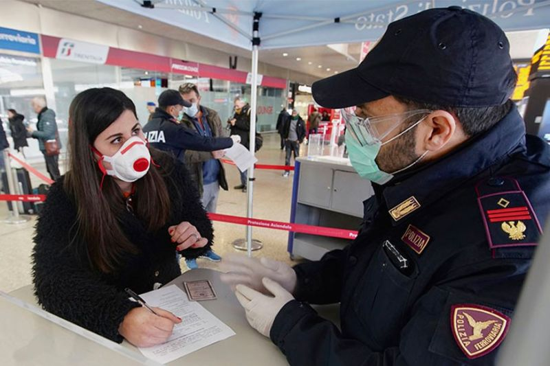 ITALY. A traveler wears a mask as she fills out a form at a check point set up by border police inside Rome's Termini train station, Tuesday, March 10, 2020. In Italy the government extended a coronavirus containment order previously limited to the country's north to the rest of the country beginning Tuesday, with soldiers and police enforcing bans. (AP)