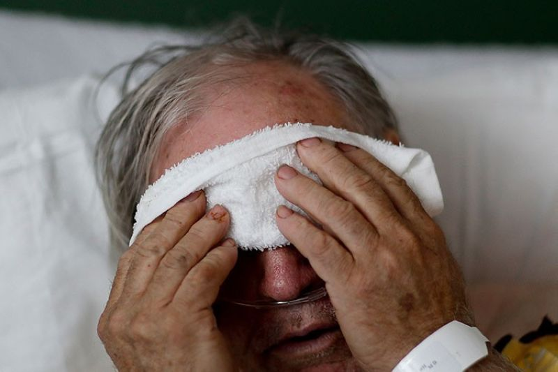 GEORGIA. In this Friday, February 9, 2018 file photo, a 73-year-old man places a cold compress on his forehead while battling the flu at a hospital in Georgia. (AP)