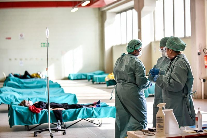 ITALY. Medical personnel work inside one of the emergency structures that were set up to ease procedures at the hospital of Brescia, Northern Italy, Tuesday, March 10, 2020. (AP)
