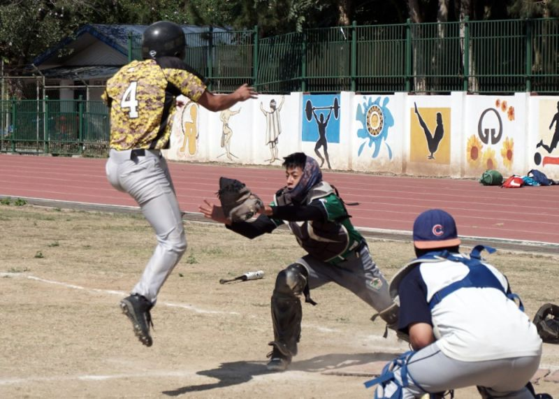 BAGUIO. A Baguio City National High School batter is tagged on the home plate by a UC Jaguars catcher during their game in the recently concluded 3rd Lawana Batted Balls Tournament. (Photo by Roderick Osis)