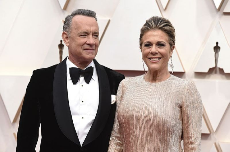 In this Feb. 9, 2020 file photo, Tom Hanks, left, and Rita Wilson arrive at the Oscars at the Dolby Theatre in Los Angeles. The couple have tested positive for the coronavirus, the actor said in a statement Wednesday, March 11. The 63-year-old actor said they will be