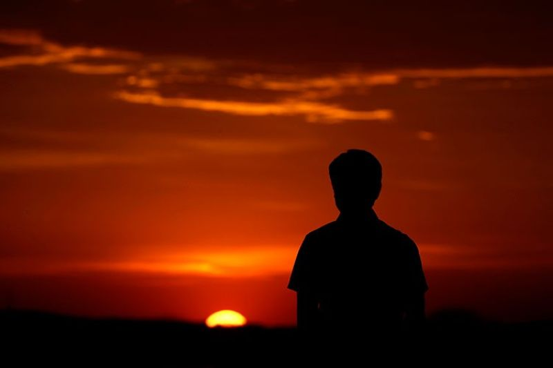 USA. In this March 7, 2020, file photo, a man watches the sunset in Kansas City, Missouri. As outbreaks of the new virus that first emerged in China continue to spread in countries, particularly those experiencing winter, one of the biggest unanswered questions is how Covid-19 will behave in warmer weather. (AP)