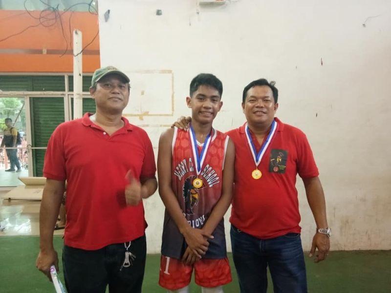 CAGAYAN DE ORO. MVP Nathan Villanueva with his Merry Child coaches. (Contributed photo)