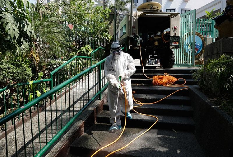 MANILA. A worker in a protective suit disinfects a school which has suspended classes as a precautionary measure against the new coronavirus in San Juan City, Manila, on Monday, March 9, 2020. (AP)