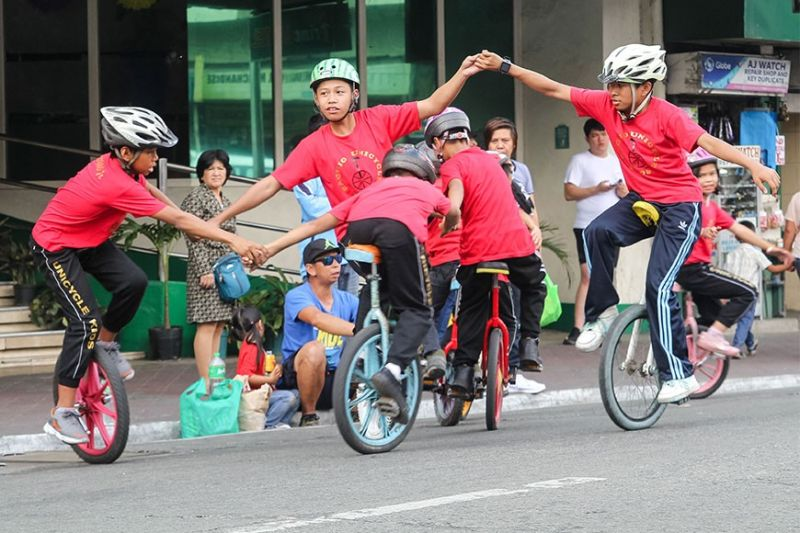 BAGUIO. A group of young cyclists freely play with their unicycle during Session Road's closure Sunday. Baguio City Mayor Benjamin Magalong suspended the closure of Session Road as precautionary measure against Covid–19. (Photo by Jean Nicole Cortes)