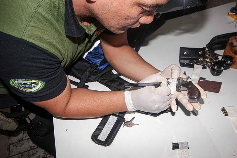 BAGUIO. An anti-narcotics agent conducts an inventory of seized items from suspected drug pushers who were nabbed during a joint operation by the PDEA, Baguio City Police Office and the National Bureau of Investigation Wednesday, March 11, 2020 in a commercial building along Bonifacio Road, Baguio City. (Photo by Jean Nicole Cortes)