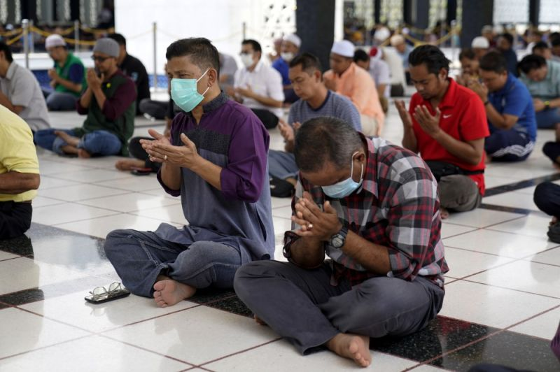 MALAYSIA. Malaysian Muslims prays during Friday prayers which was held with shorter sermons to prevent the spread of new coronavirus at the National Mosque in Kuala Lumpur, Malaysia, Friday, March 13, 2020. For most people, the new coronavirus causes only mild or moderate symptoms. For some it can cause more severe illness. (AP)