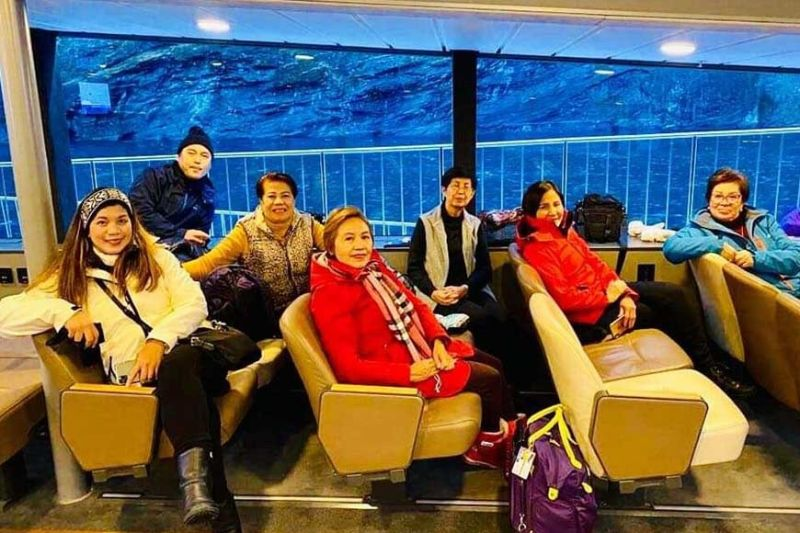 NORWAY. Relaxing inside a liner that brought us on a fjord tour are: Arlene S., Erwin, Emma, the author, Genie, Arlene M., and Zeny. (Photo by Debb Bautista)