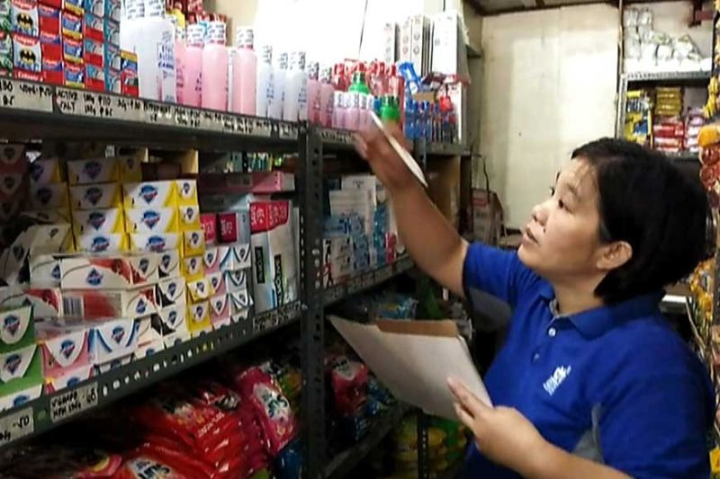 BAGUIO. Abrella Dangla from the Department of Trade and Industry conducts price monitoring at one of the grocery stores in the capital town of Bontoc in Mountain Province particularly alcohol as supply starts to deplet. Earlier on March 11, the DTI together with Department of Health provincial office conducted the same and warned violators for overpricing. (Photo by Ferdie Cariño Castañeda)