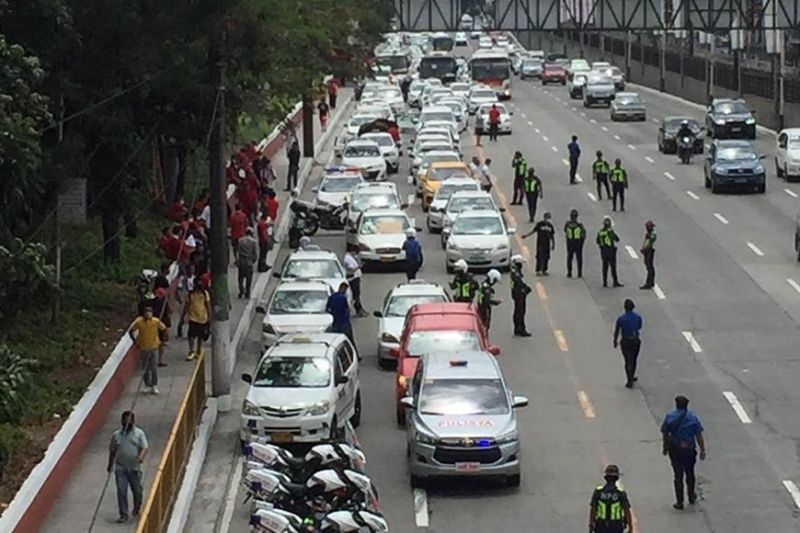 MANILA. Police apprehend about 600 public utility vehicles Edsa on March 17, 2020 as part of enhanced community quarantine measures. (Photo by Third Anne Peralta-Malonzo)