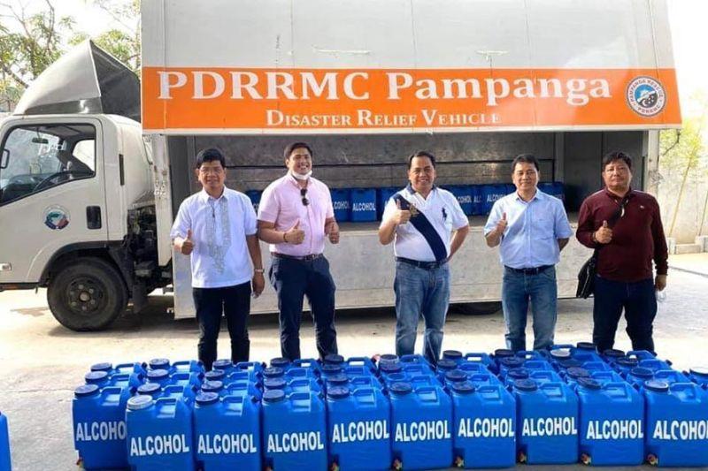 PAMPANGA. Apalit Mayor Oscar Tetangco Jr., Vice Mayor Peter Nucom and councilors Kenneth Nunag, Junjun Mendoza and Pol Nabong show the gallons of ethyl alcohol donated by the municipality to Pampanga's 11 district hospitals. (Contributed photo)