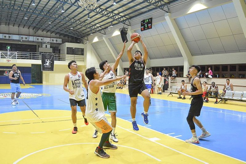 SEE YOU POST-COVID. Hell Energy Drink's James Ferraren (with ball) finishes with a double-double to win the MVP award of the Upperclass Cebu Basketball League. It was the last activity of the league as it suspended the season due to the Covid-19 outbreak. (Contributed Photo)