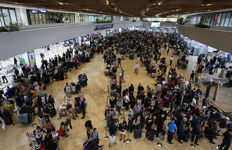 MANILA. In this handout photo provided by the Manila International Airport Authority Media Affairs, passengers wait for their flight at the departure area of Manila's International Airport, Philippines on Tuesday, March 17, 2020, while the government implements a localized quarantine as a precautionary measure against the spread of the new coronavirus. (AP)