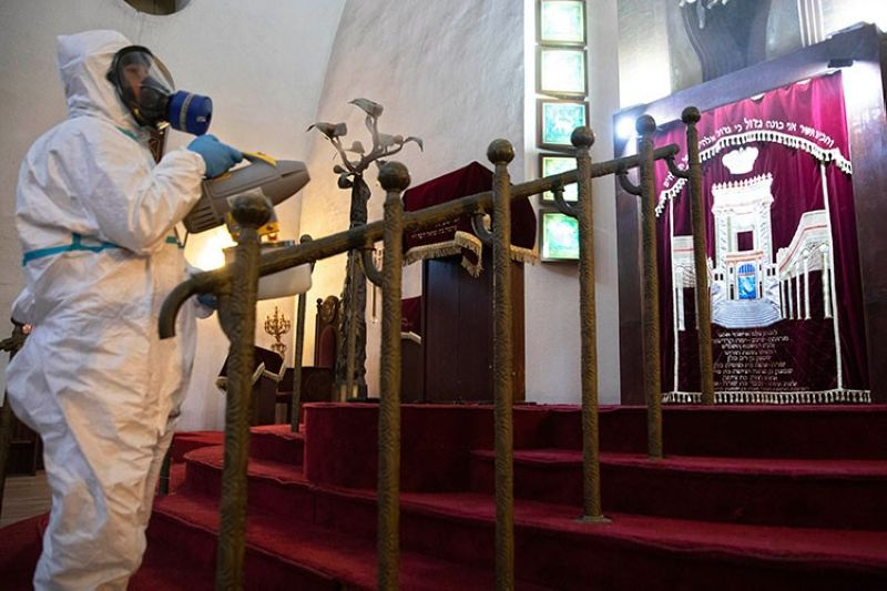 ISRAEL. Workers spray disinfectant as a precaution against the coronavirus at the Great Synagogue in Tel Aviv, Israel, Tuesday, March 17, 2020. (AP)