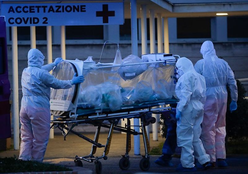 ITALY. A patient in a biocontainment unit is carried on a stretcher at the Columbus Covid 2 Hospital in Rome, Monday, March 16, 2020. (AP)
