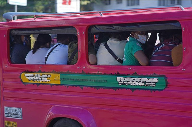 DAVAO. City Government of Davao now requires public commuters to wear masks while riding public utility vehicles (PUVs) and to observe one-meter social distancing as measures against Covid-19. However, it can be observed that social distancing is not being practiced in some PUVs. (Macky Lim)