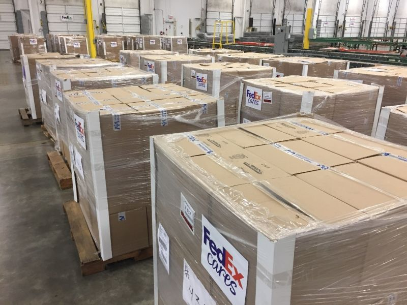 MANILA. Pallets of aid from International Medical Corps and Heart to Heart International are prepared as part of FedEx Express charitable giving. (Contributed photo)