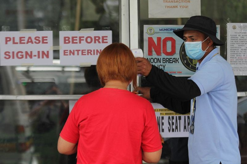 BAGUIO. All employees and individuals are screened before entering the La Trinidad Municipal Hall following safety protocol to combat the spread of the coronavirus disease (Covid-19) pandemic. (Photo by Jean Nicole Cortes)