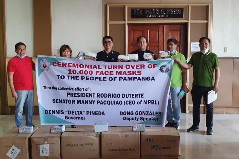 PAMPANGA. Governor Dennis Pineda, Board Member Ananias Canlas, Jr., and Provincial Disaster Risk Reduction and Management Office Head Agelina Blanco receive the 10,000 mask donation from Senator Manny Pacquiao and 3rd District Representative Aurelio Gonzales, Jr. during the turnover on Wednesday, March 18, 2020 at the Capitol Building. (Contributed photo)