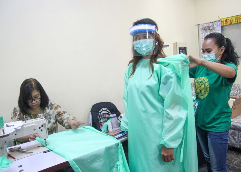 BAGUIO. Battle gear production. Employees of the Baguio General Hospital and Medical Center make water resistant protective gowns and face covers for health workers in the front lines. (Photo by Jean Nicole Cortes)