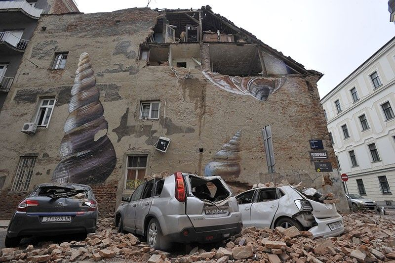 CROATIA. A collapsed wall leaves an exposed home and crushed cars after an earthquake in Zagreb, Croatia, Sunday, March 22, 2020. A strong earthquake shook Croatia and its capital on Sunday, causing widespread damage and panic. (AP)