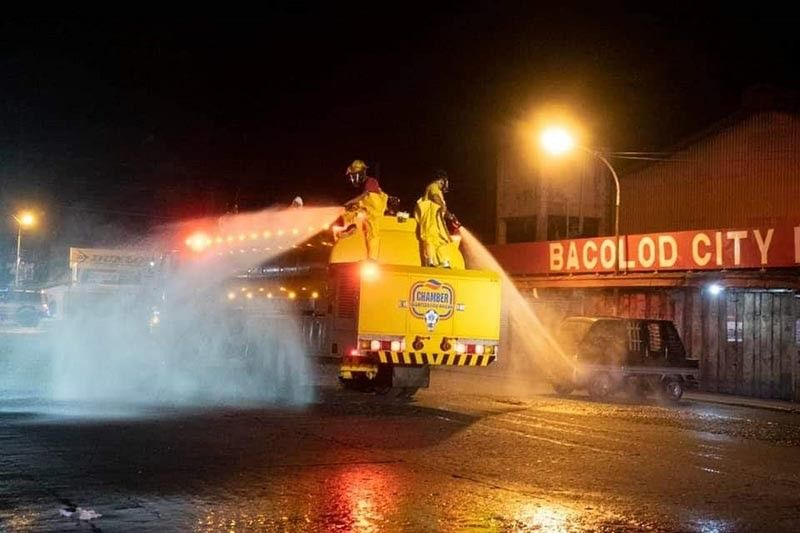 BACOLOD. Chamber Volunteer Fire Brigade volunteers initiated the disinfection of some vital streets in Bacolod City on March 22 to help ensure a sanitized community. These aim to get free the streets of the possible tinges of coronavirus. (Contributed photo)