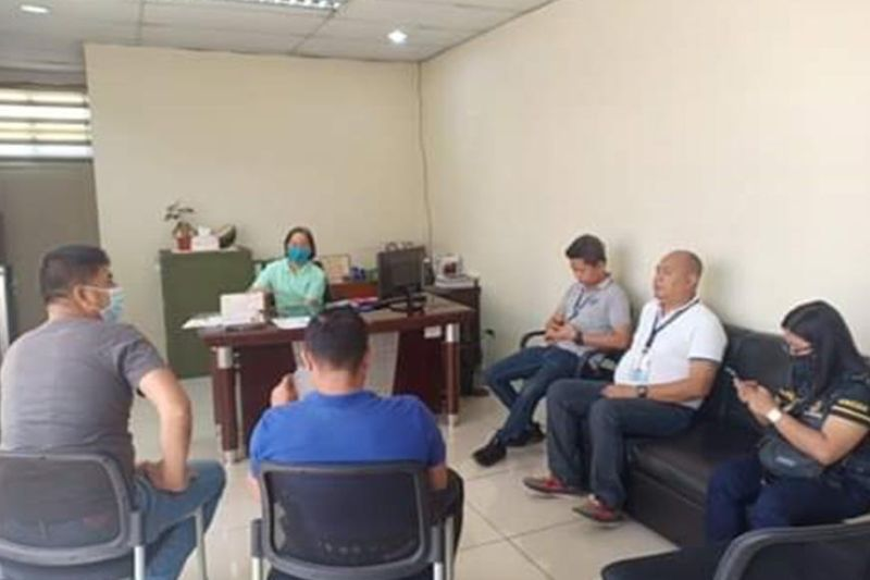 BACOLOD. DTI-Negros Occidental officials and personnel led by officer-in-charge Provincial Director Rachel Nufable meet with representatives of the National Bureau of Investigation - Bacolod at their office in the city Monday, March 23, 2020. (Contributed Photo)