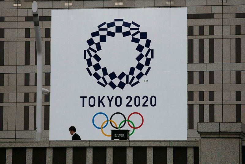 JAPAN. A man walks past a large banner promoting the Tokyo 2020 Olympics in Tokyo, Monday, March 23, 2020. The IOC will take up to four weeks to consider postponing the Tokyo Olympics amid mounting criticism of its handling of the coronavirus crisis that now includes Canada saying it won't send a team to the games this year and the leader of track and field, the biggest sport at the games, also calling for a delay. (AP)