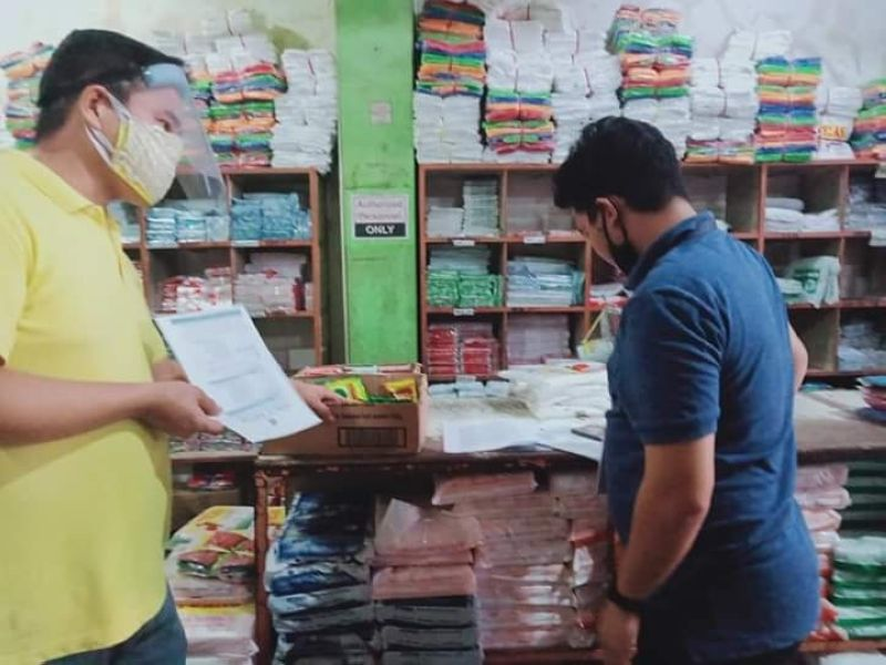 BACOLOD. Negosyo Center - Kabankalan business counselor Victor Alamon (right) conducts monitoring of price and supply of basic goods at one of the retail stores in the southern Negros Occidental city on Tuesday, March 24. (Contributed Photo)