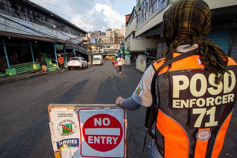 BAGUIO. Aside from police, POSD enforcers and barangay officials carry the responsibility to watch over their localities and apprehend curfew violators. (Photo by Jean Nicole Cortes)