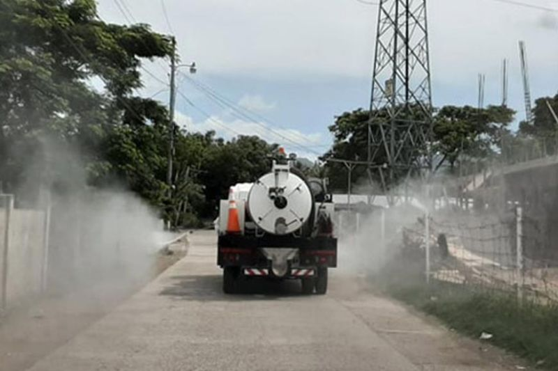 ZAMBOANGA. The City Government on Wednesday, March 26, uses the water tanker of the City Disaster Risk Reduction Management Office to disinfect the community where the patient confirmed with Covid-19 resides in the village of Sinunuc, Zamboanga City. (City Hall Information Office photo)
