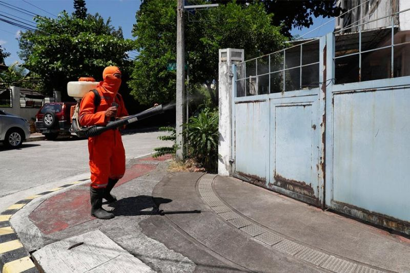 A village worker wearing a protective suit uses a machine to spray disinfectants inside a village as a precautionary measure to prevent the spread of the new coronavirus in Metro Manila, Philippines on Thursday, March 26, 2020. The new coronavirus causes mild or moderate symptoms for most people, but for some, especially older adults and people with existing health problems, it can cause more severe illness or death. (AP Photo/Aaron Favila)