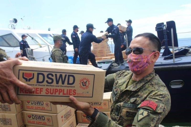 Army assists relief efforts BACOLOD. The 303rd Infantry Brigade provides manpower and transportation assistance during the hauling and prepositioning of family food packs in key areas in Negros Occidental Thursday, March 26, 2020. (Contributed photo)