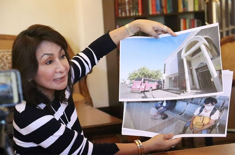 CEBU. Governor Gwen Garcia shows pictures of people waiting in line outside the South Bus Terminal on Friday, March 27, 2020. (Amper Campana)