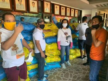 PAMPANGA. Sto. Tomas Mayor Gloria Ronquillo together with MSWD and MDRRMO undertake the repacking of rice and can goods to be delivered to residents in all villages of the town as part of the local government unit's food assistance amidst the Covid-19 pandemic. (Chris Navarro)