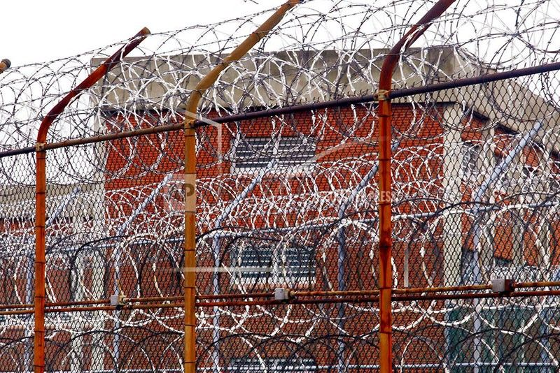 NEW YORK. In this March 16, 2011, file photo, a security fence surrounds inmate housing on the Rikers Island correctional facility in New York. Health experts say prisons and jails are considered a potential epicenter for America's coronavirus pandemic. (AP)
