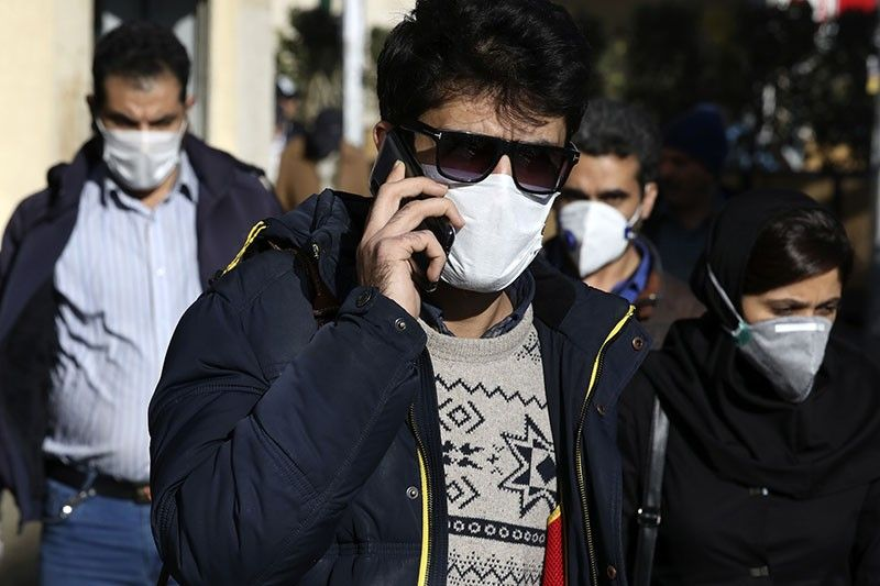 IRAN. In this Monday, March 2, 2020 file photo, a man wearing a face mask, to help protect against the new coronavirus, speaks on his cellphone in downtown Tehran, Iran. Local media reported Thursday, March 26, 2020, that nearly 300 people have been killed and more than 1,000 sickened by ingesting toxic methanol across the Islamic Republic out of the false belief it kills the new coronavirus. That's as messages forwarded through social media on people surviving the virus by drinking whiskey and using alcohol-based hand sanitizer somehow saw people seek out bootleg liquor in Iran. (AP)