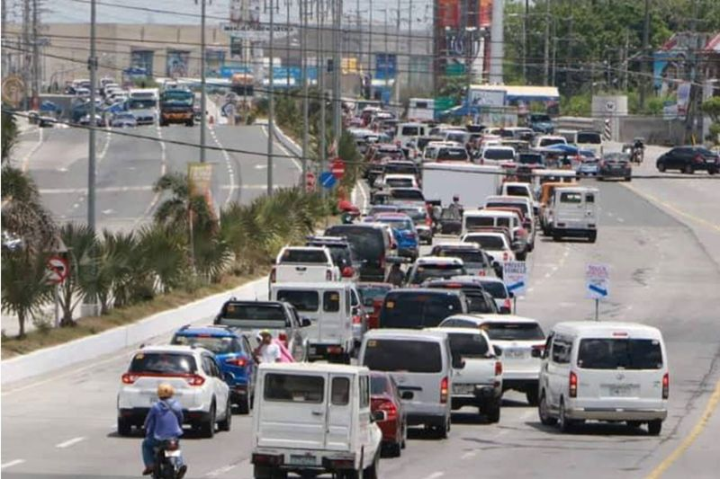 Vehicles pile-up along the Jose Abad Santos Avenue near Paskuhan Village in the City of San Fernando as police conduct check points amid the Enhanced Community Quarantine or Luzon Lockdown to address the COVID-19 pandemic. (Chris Navarro)