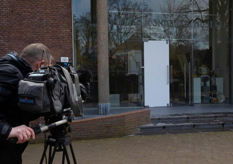 NETHERLANDS. A cameraman films the glass door which was smashed during a break-in at the Singer Museum in Laren, Netherlands, Monday March 30, 2020. Police are investigating a break-in at a Dutch art museum that is currently closed because of restrictions aimed at slowing the spread of the coronavirus, the museum and police said Monday. (AP)