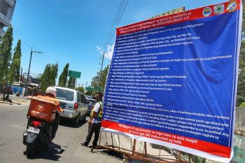 PRAY YOU'RE ON THE LIST. On the first day of the enhanced community quarantine declared by the Cebu Provincial Government on Monday, March 30, 2020, a big sign in the Barangay Bulacao boundary of Talisay City provides a list of the only persons allowed to enter and exit Talisay City under Cebu Gov. Gwendolyn Garcia's Executive Order 5-O. (Sunstar Photo / Amper Campaña)