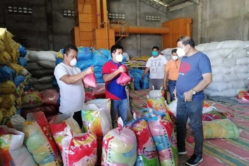 PAMPANGA. Mayor Rene Maglanque, Vice Mayor Michael Sagum and Councilor Siso Maglanque check on the relief packs from the local government to be distributed to residents of Candaba. (Contributed photo)