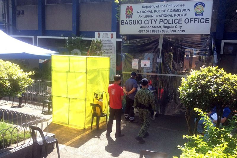 BAGUIO. Police and civilians entering the Baguio City Police Office (BCPO) undergo disinfection, thermal scanning and use of foot bath before they are allowed entry at the police office. (Photo by Jonathan T. Llanes)