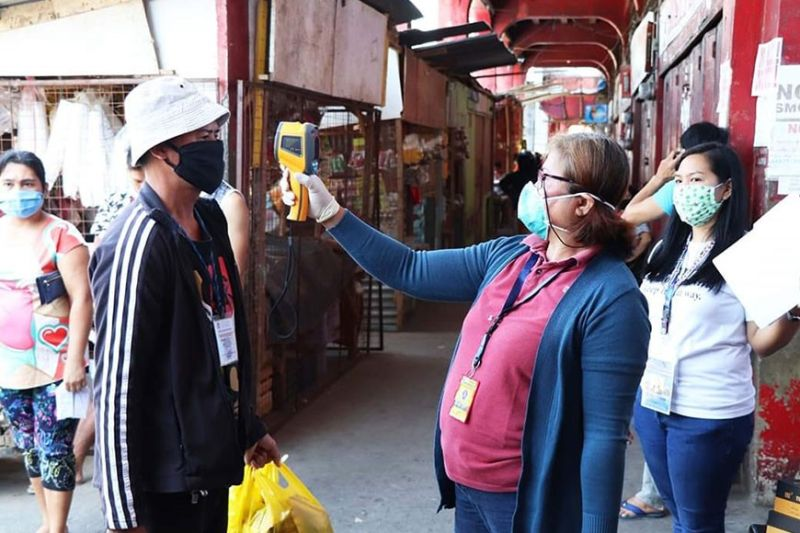 BACOLOD. Silaynons submit themselves to thermal scan and spraying of disinfectants in all checkpoints in their area as a form of their compliance of the enforcement of the enhanced community quarantine. (Coontributed photo)