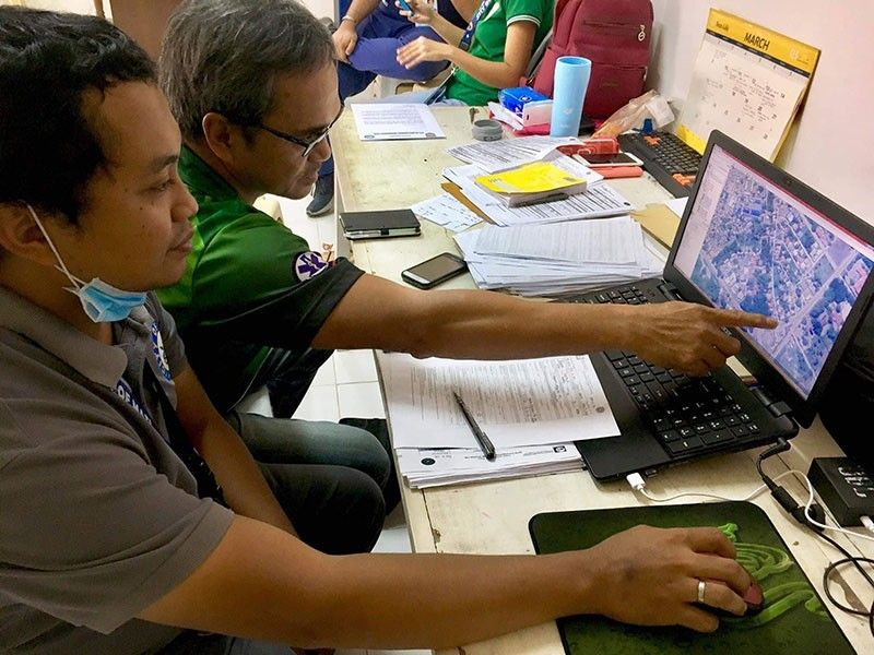 DAVAO. Mati City Incident Management Team checked the locations of Covid-19 cases. (Photo by Ben Tesiorna)