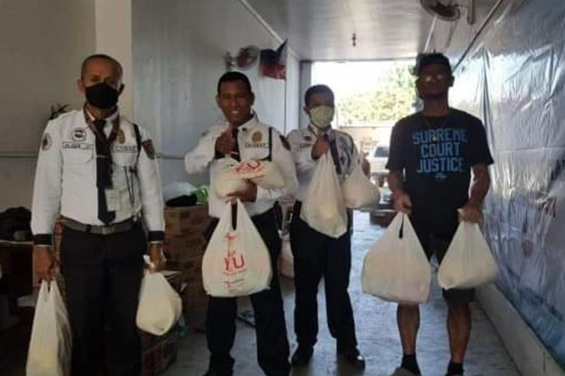 BACOLOD. These security guards are among the recipients of the family food packs distributed by the members of Department of Agrarian Reform Rank and File Employees Union Friday, April 3, 2020. (Contributed Photo)
