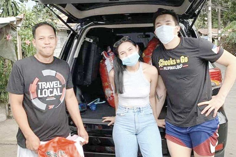 HELPING OUT. Former Cebu Schools Athletic Foundation Inc. Juniors MVP Paul Desiderio and fiancée Agatha Uvero are doing their part in helping out poor communities during the Covid-19 crisis. (Contributed Photo)